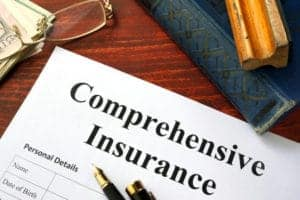 Picture of Comprehensive Insurance Designations form on office table