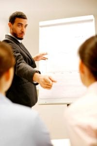 Picture Businessman Costly Workers Comp Giving Presentation