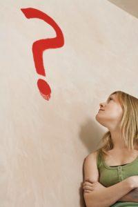 Woman Looking North Dakota Conundrum Question Mark On Wall