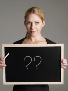 Picture Woman Holding Blackboard Subrogation Question Marks