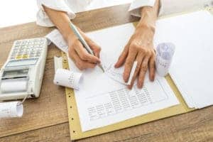 Picture of Woman doing Payroll Audit Dispute by hand