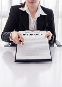Picture of Woman George Hohmann Holding Insurance Paper