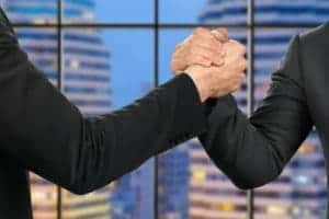 Picture of two business man shaking hand George Hohmann showing mutual company