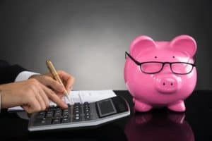 Picture of Auditor Huge workers comp Audit Bill With Piggy Bank On Table
