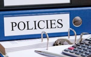 Picture of Policies Files 180 Day Window on table and Calculator