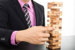Picture of Man with jenga game AIG failure