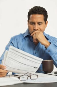 Picture Man reading Premium Audit Bills Form