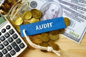 Picture of audit tag and calculator and money Premium Audit Bills Another Question