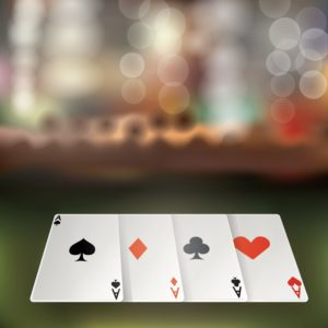 Picture of Gamble Cards with blurred background Workers Comp Gamble insurance premiums