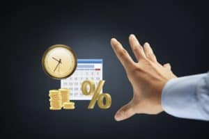 Hand Presenting Interchange Of Labor Rule Coins Percentage Calendar And Clock