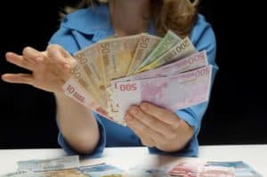 Lady Holding Small Claim Money
