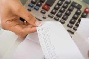Woman Calculating Misconceptions Part III With Receipt