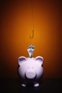 Money In Piggy Bank Slot Misconceptions Part III Fishing Hook Hanging Above Image