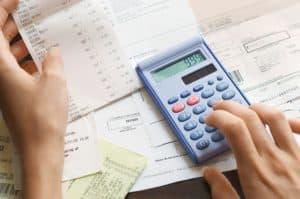 Calculating Workers Comp Premiums Bills Image