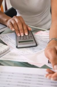 Picture Woman Calculating Small Deductible Bills