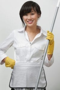 Woman Holding Housekeeping Items Image