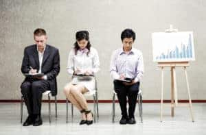 Picture of Three Employees Assigned Risk Pool Writing With Rating Board On Side