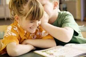 Boy Whispering Into Girl Ear Five Secrets Picture