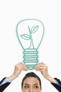 Woman Workers Compensation Reserves Holding Up Cut Out Light Bulb