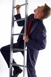 Picture Businessman Climbing Up Workers Compensation Insurance Ladder