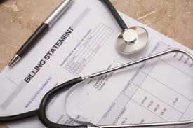 Picture of Workers Compensation Medical Bill Fee Paper and Stethoscope