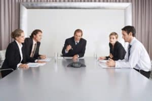 Business People Five Fixes Listening During Teleconference