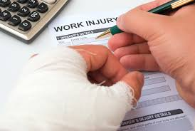 Picture of Injured Hand Signing workers comp bulletin Work Injury Form