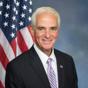 Picture Of Governor Charlie Crist Improvements Vetoed USA Flag At The Back