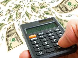 Picture Of Calculator And Dollars Loss Reserves Workers Comp Term