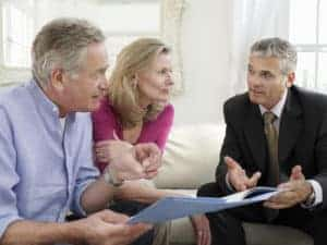 Picture of Couple And Workers Comp Consultant On Sofa