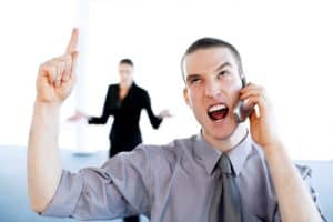 Picture Businessman Talking Angrily Workers Comp Declarations on the Mobile Phone