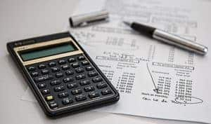 Picture Of Calculator Actuary With Paper And Pen