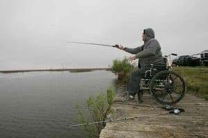 Picture Of Man In Wheelchair Disability Rating While Fishing