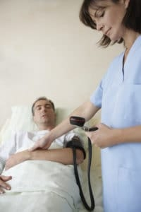 Picture Of Nurse Took BP Of Patient Utilization Review Medical Treatment