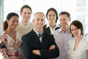 Picture Of Workers Comp Takes Another Step Coworkers In Office