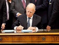 Picture Of Governor Signs Bill People At the Back