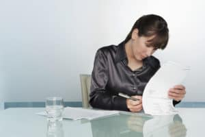 Picture Of Woman Writing On Paper Policy Provisions On Table