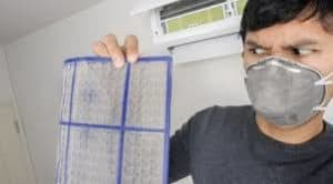 picture of man avoiding cleaners asthma by wearing mask
