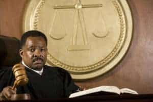 Picture Of Judge Holding Gavel Adjudication In Court