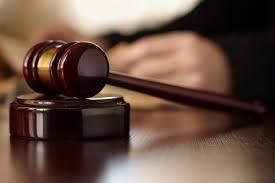 Blurry Picture Of Gavel Adjudication Judge