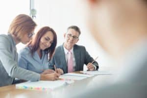 Business People Captive Insurance Arrangements At Conference Table