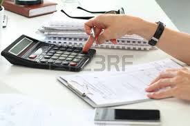 Picture of Partial Retention Risk Management Calculating On Table
