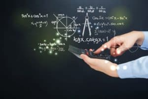 Hand Holding Calculator WCIRB And NCCI With Formula