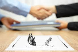 Picture of Agreement Workers Comp Mediations Shaking hands