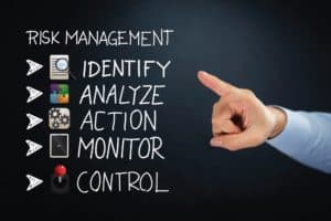 Hand Pointing Certified Risk Manager Concept