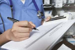 Picture of Doctor Writing Fee Schedule of Patient
