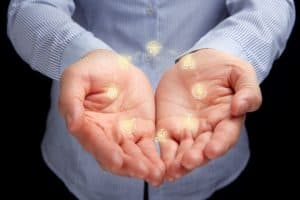 Hand Presenting Workers Comp Policy Just Renewed Insurance Carrier