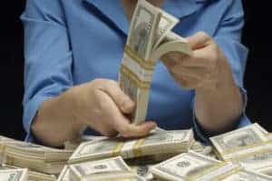 Picture Of Woman Workers Comp Policy Just Renewed Counting Money