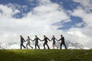 Picture Of Business People Holding Hands Residual Market And Waking In Row