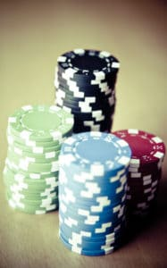 Picture of chips in gamble Term Of The Day Pure Risk